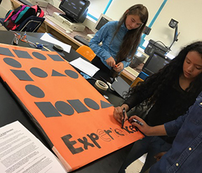 Forest Grove SMILE Club students create signs for parade