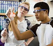 high school students in a lab
