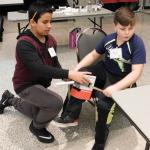 Boys at MS Challenge work on prosthetic leg design