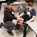 Boys at MS Challenge work on prosthetic leg design