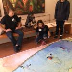 Students operate robot on map
