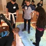 Students detach robot from launch and recovery arm