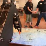 Students bring robot to map to test programming