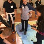 Students lower robot with launch and recovery arm