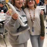 Students pose with their prosthetic leg