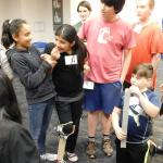 A team of students test their prosthetic leg design